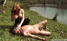 Tough Adriana Rodrigues roughs up her slave boy.